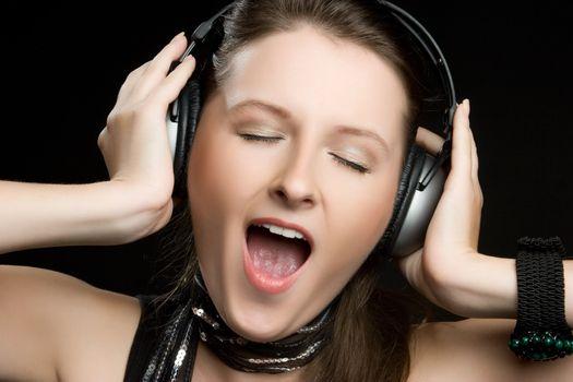 Beautiful singing headphones music woman
