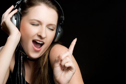 Singing happy headphones music girl