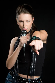 Beautiful singing woman holding microphone