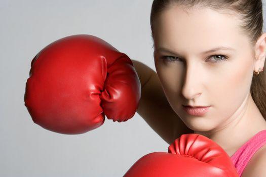 Beautiful aggressive female boxer woman