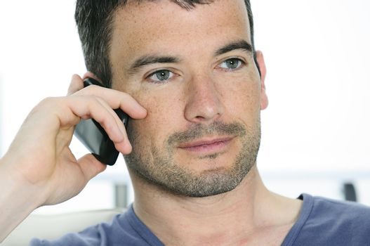 relaxed man with having a communication with a cellephone