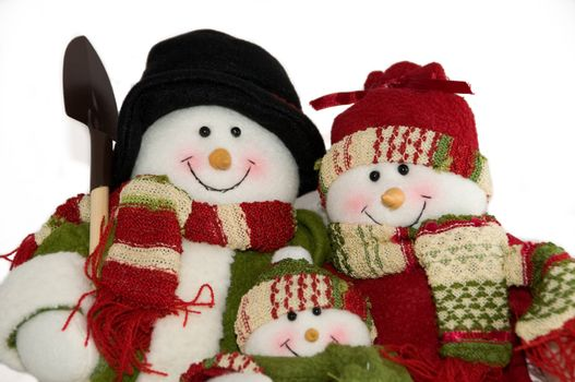 Toy decoration - a family of snowpeople