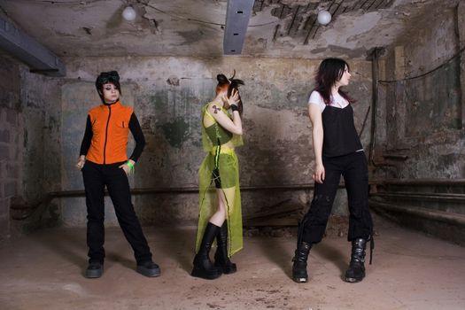 Girls of goth in a gloomy, dirty, terrible cellar