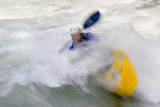 Kayaker in whitewater rapids - motion blurred