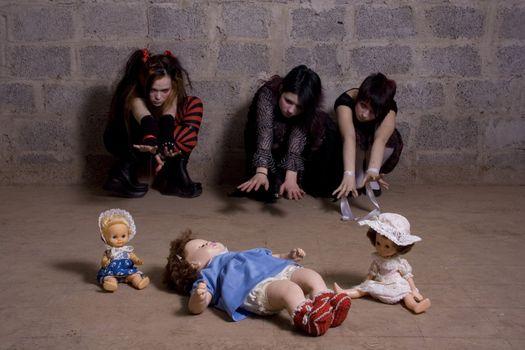 Sad, gloomy girls pull hands to dolls