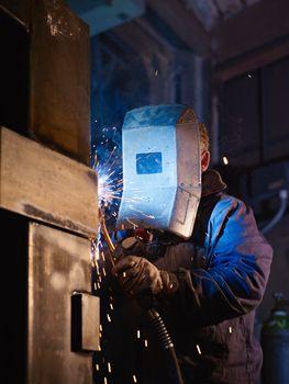 Man at work as welder in heavy industry