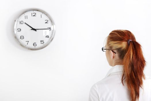 Caucasian woman looking at the clock