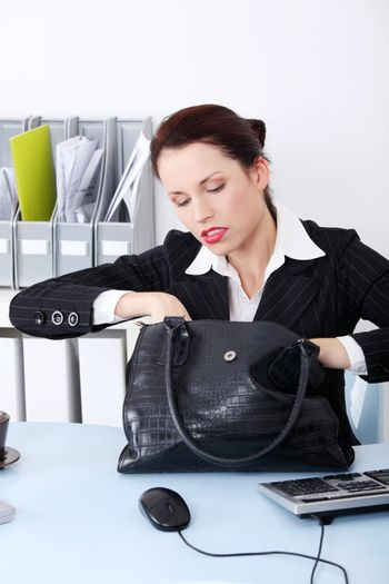 Businesswoman searching in her bag.