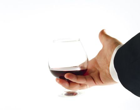 Hand with glass of wine on white background. Isolated object.
