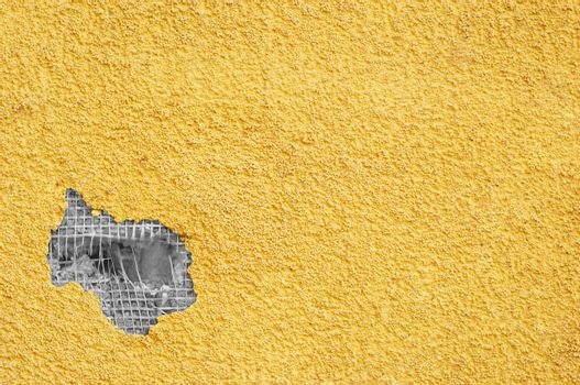 yellow punched stucco