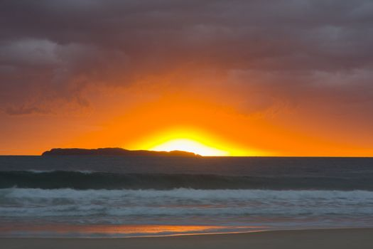 Sunrise on the beach on a stormy day