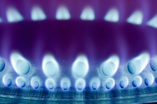 Flame of a gas stove in the dark - close up