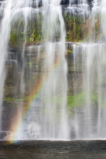 Tropical waterfall with colorful rainbow in Brazil