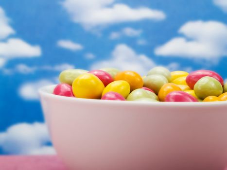 Colorful candies over a blue sky