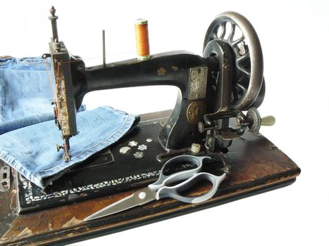 Vintage sewing machine and modern jeans