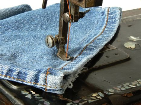 clousup of old sewing machine and jeans
