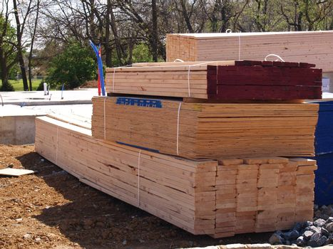 a pile of lumber ready for framing for a new home