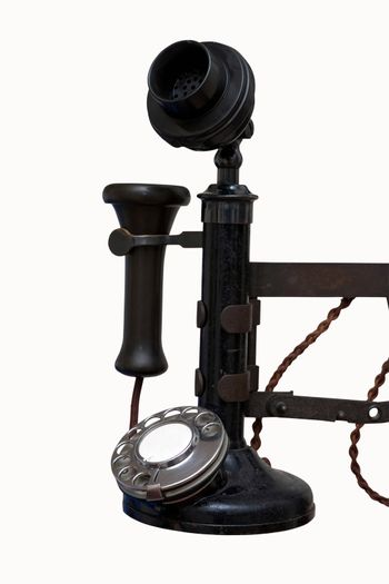The handset of a vintage wall phone