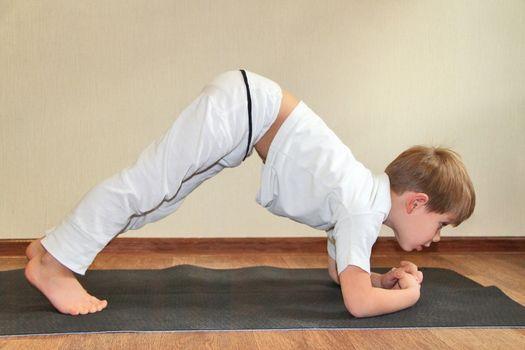 Baby yoga at home. Rabbit pose, sasangasana