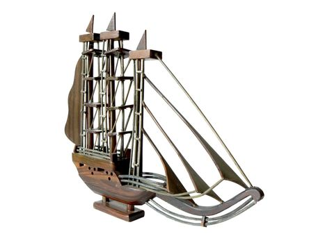 wooden model of sailboat isolated on white