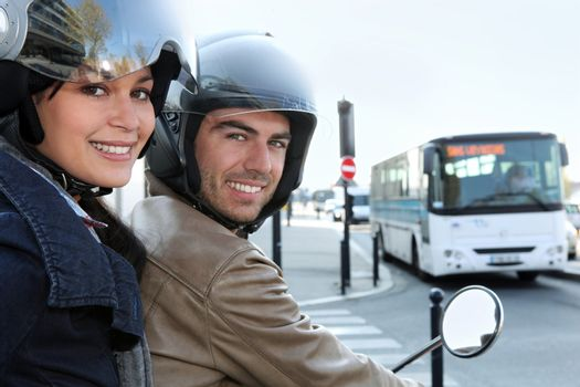 Couple on scooter in a crossroad