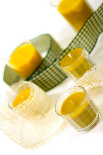 five yellow candles and ribbon