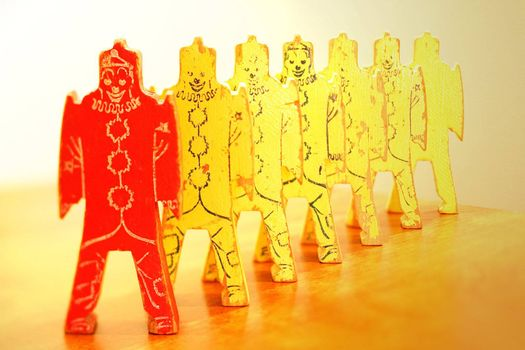 A line of vintage clowns with one red and 6 yellow