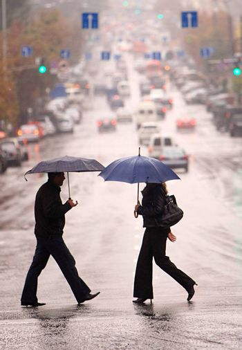 urban people cross the street on the rain