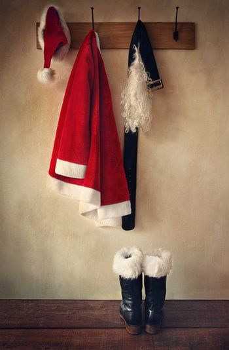 Santa costume with boots on coatrack
