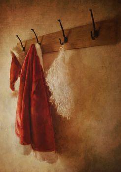 Santa costume hanging on coat rack