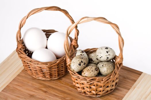 eggs in basket isolated on a white background