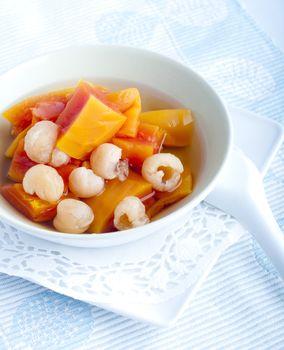 Natural and healthy Chinese dessert, cooked papaya with longan.