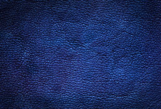 Blue leather background.  Abstract natural dark texture.