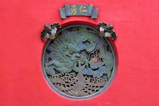 Carved dragon in Buddhism Temple.
