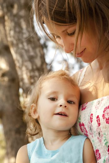 Little girl and mother in the park