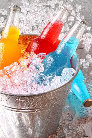 Bottles of cooler drinks with ice