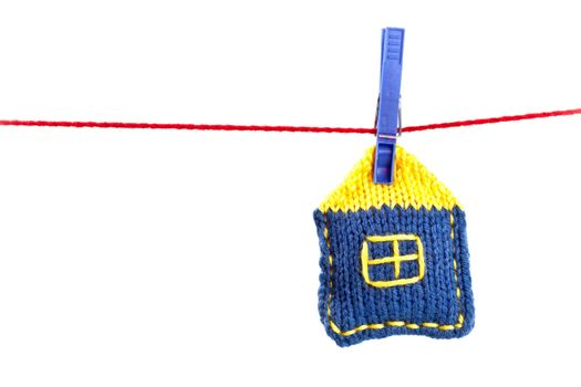 knitted house on a red string