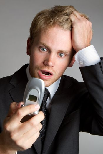 Frustrated shocked phone business man