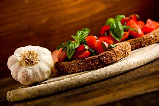 Bruschetta appetizer with fresh tomatoes