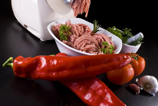 Meat grinder with mince and vegetables