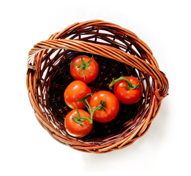tomatoes in the rattan basket. Top view