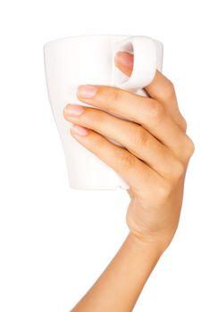 Hand holding coffee mug with white background.