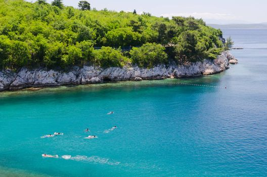 group of teenagers swimming in adriatic sea