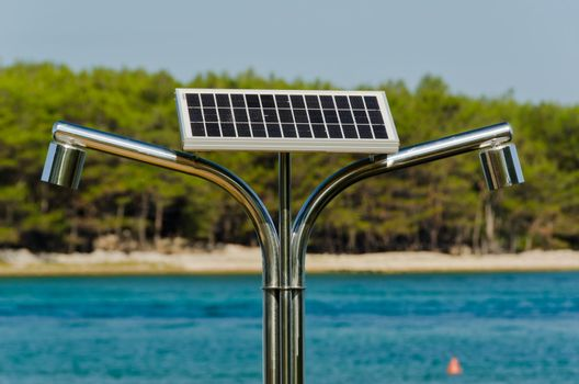 energy efficient solar shower on a beach