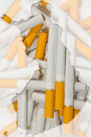Outline map of Finland with cigarettes in background