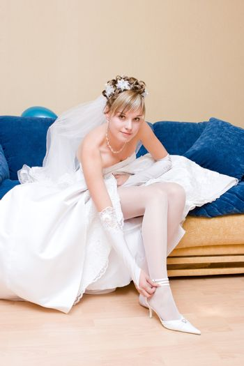 a bride putting on a shoe