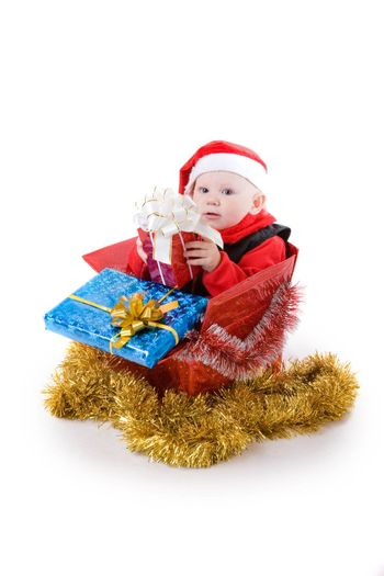 happy infant with gifts in the decorated christmas box