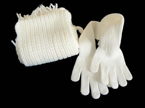 White woolen Scarf and gloves on black background