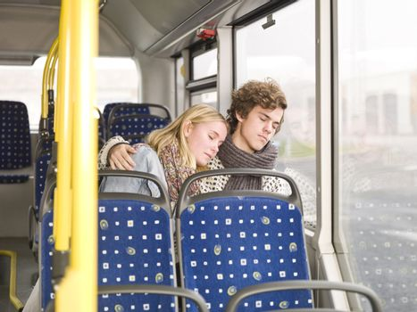 Young couple sleeps on the bus