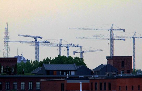 City scape covered with a line of construction cranes